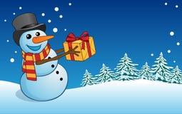 Postkarten-Weihnachts- und des neuen Jahresschneemann mit Geschenk Stockfoto