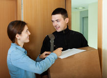 Postman brought package. Courier brought package to girl at home stock image