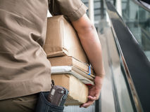 Postman carrying parcels Stock Photos