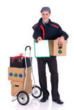 Postman Christmas delivery. Young handsome postman making a Christmas holiday delivery, post package. Studio, white background stock photo