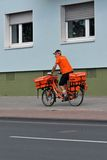 A postman in Cologne Stock Photo