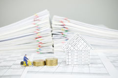 Postman cycling pass step pile of gold coins and house Royalty Free Stock Photo