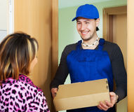 Postman delivered a parcel to girl Stock Images