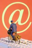 Postman delivering E-mails Stock Images