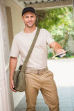 Postman delivering a letter Royalty Free Stock Image