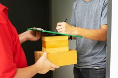 Free Postman Delivering Package Of Goods To Home. Selective Focus On The Hands. Home Delivery Concept, Deliver Packages To Recipients Stock Photography - 157837182