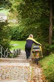 The postman delivers mail on a bicycle Stock Photos