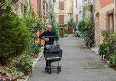 The postman delivers mail on the street Stock Photos