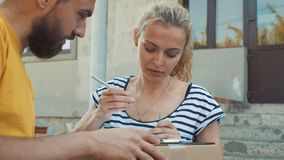 The postman delivers a parcel for a young woman stock footage