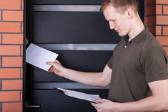 Postman giving letter Stock Image