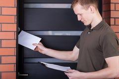 Postman giving letter Stock Image