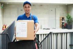 Postman. Happy postman giving you a big bag royalty free stock images