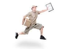 Postman on a hurry delivering package. Isolated on white royalty free stock images