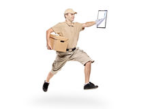 Postman in a hurry delivering package Royalty Free Stock Photo