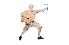 Postman in a hurry delivering package Royalty Free Stock Photos