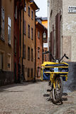 Postman's Bike in old town, Stockholm, Sweden Royalty Free Stock Photo