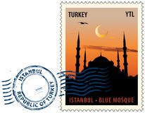 Postmark from Istanbul. Postmark with night sight of  the Sultan Ahmed Mosque or Blue Mosque in Istanbul against sunset sky Stock Photography