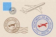 Postmarks and postal elements on beige background. Vector illustration Stock Images
