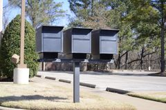 Postmaster General Approved Mailboxes. Multiple secure and locked mailboxes in a central location at some apartments, condos or high-rise residential homes, that Stock Images