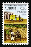 Postmen and delivery transportation, Stamp day, Philately serie, circa 1970. MOSCOW, RUSSIA - OCTOBER 1, 2017: A stamp printed in Algeria shows Postmen and royalty free stock photos