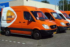 PostNL Post.nl van. Almere, Flevoland, The Netherlands - August 21, 2015: A row of PostNL delivery trucks parked on the street of Almere. PostNL Post.nl is a royalty free stock photo