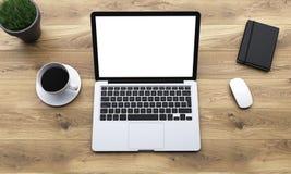 Posto di lavoro con il computer portatile Fotografie Stock