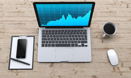 Posto di lavoro con il computer portatile, smartphone, caffè, blocco note Immagine Stock
