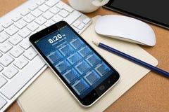 Posto di lavoro con il telefono cellulare Fotografie Stock
