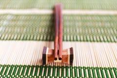 Posto di legno dei bastoncini sul supporto di legno Fotografia Stock Libera da Diritti