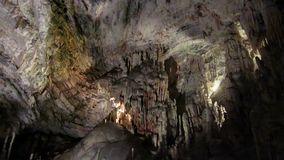 Postojna cave with limestone pilons. Postojna cave world attraction under the ground in Slovenia, the biggest cave in the world
