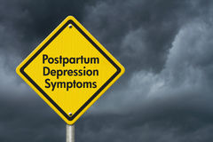 Postpartum Depression Symptoms Warning Sign. Yellow Caution sign with words Postpartum Depression Symptoms with stormy sky background stock image