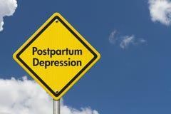 Postpartum Depression Warning Sign. Yellow Caution sign with words Postpartum Depression with sky background Stock Photos