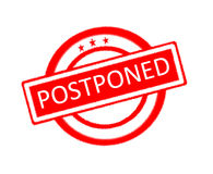 Postponed word written on red rubber stamp Stock Photos