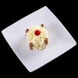 Postre poner crema delicioso en la placa Foto de archivo libre de regalías