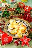 Postre y decoración de la Navidad Foto de archivo