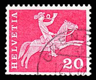 Postrider (19th century), Postal history motives and monuments serie, circa 1960. MOSCOW, RUSSIA - FEBRUARY 10, 2019: A stamp printed in Switzerland shows royalty free stock photography