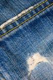 Postrzępeni niebiescy dżinsy Zdjęcia Royalty Free