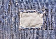 Postrzępiony niebiescy dżinsy zbliżenie Zdjęcia Royalty Free