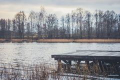 Wooden pier on the shore of the lake Stock Photography