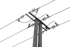 Posts de la electricidad aislados en blanco Fotografía de archivo libre de regalías