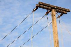 Posts de la electricidad en el cielo Imagen de archivo