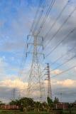 Posts de la electricidad por la tarde Imagen de archivo libre de regalías