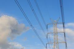 Posts de la electricidad por la tarde Foto de archivo libre de regalías