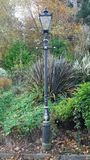 Posts de la lámpara en un parque foto de archivo libre de regalías