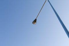 Posts de la luz de la silueta durante subida del sol Fotos de archivo libres de regalías
