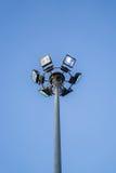 Posts del proyector y cielo azul Fotografía de archivo