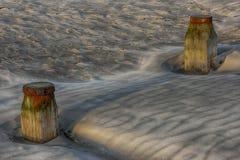 Posts en la arena Fotografía de archivo libre de regalías