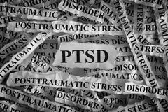 Posttraumatic stress disorder. Torn pieces of paper with abbreviate PTSD. Posttraumatic stress disorder. Concept Image. Closeup Royalty Free Stock Image