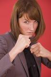 Postura de la lucha interna de la mujer de negocios Imágenes de archivo libres de regalías