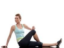 Postura del entrenamiento de los abdominals del entrenamiento de la mujer Fotografía de archivo